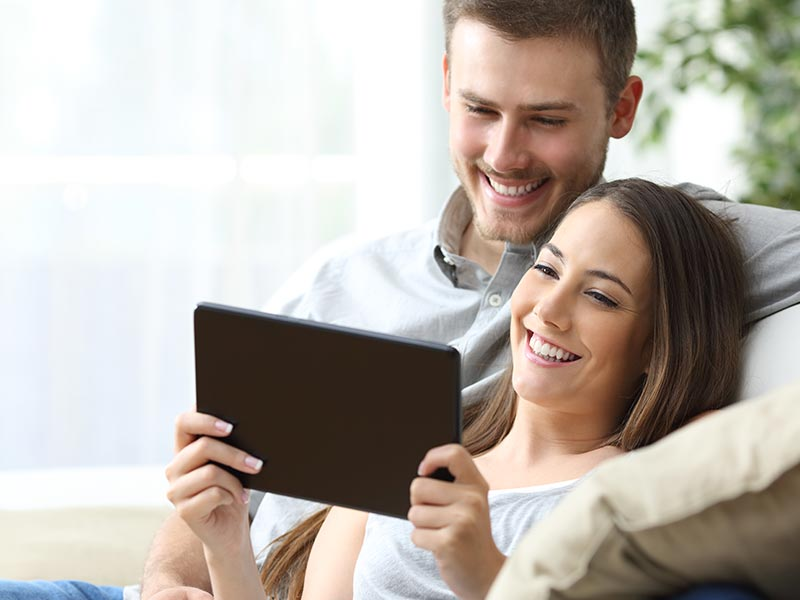Couple holding tablet