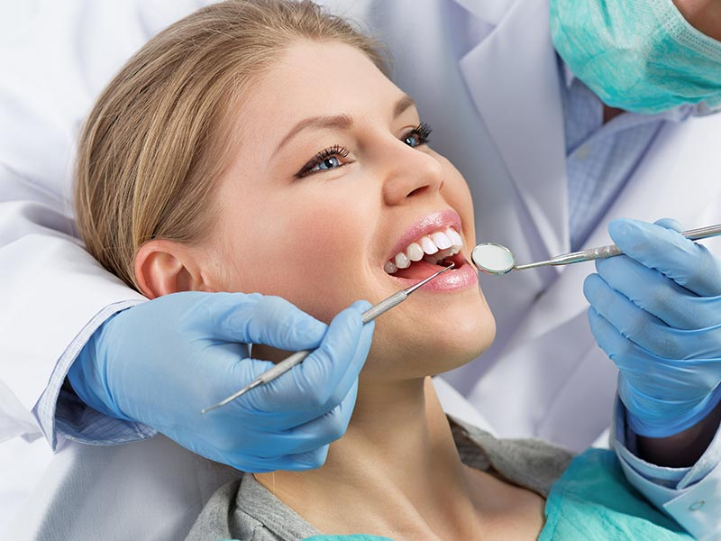 Patient receiving dental treatment